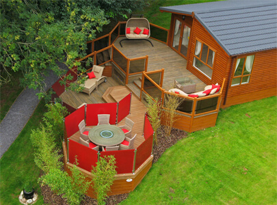 AB Sundecks Decking and Steel Red Glass on Lodge with an array of tables, chairs and sunbeds