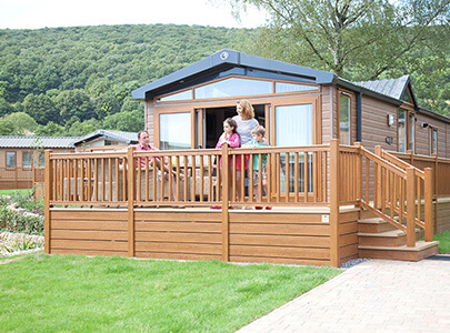 AB Sundecks Picket Panel and Steps on raised Decking with family